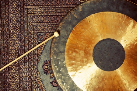 Gong resting on an asian rug