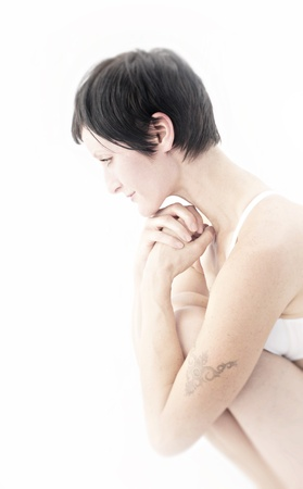 Gentle woman self reflecting in her physical being Stock Photo - 17124031