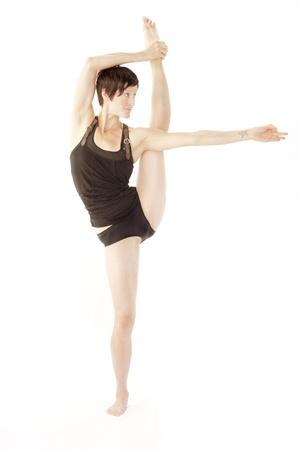 Beautiful creative woman in precision yoga pose