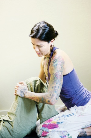 thai yoga: Thai yoga therapist working on her client