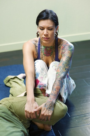 Woman practicing Thai Yoga therapy on her client  photo