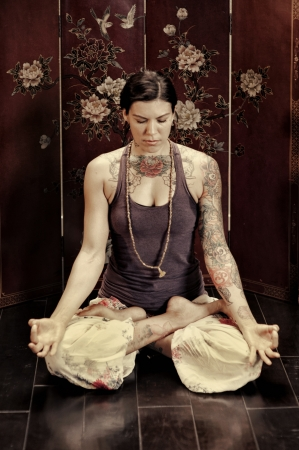 quietly: Young woman meditating quietly