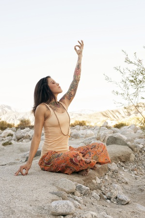 mind body soul: Yoga Woman outdoors touching earth and sky