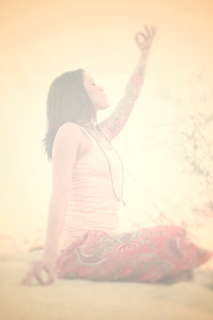 Blurred solarized colored image of woman in exhalted meditation   Stock Photo