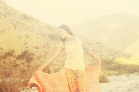 Blurred image of dreaming woman in free flow mountain magic  photo