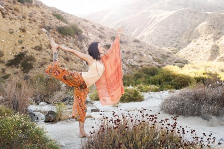 Woman outdoors in the yoga pose natarajasana or dancer