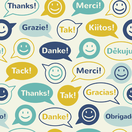 Colorful speech bubbles with smiles and thank you in different languages. Seamless vector pattern. Flat design.