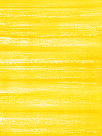 Abstract hand drawn background or texture. Yellow acrylic fill with brush streaks or stripes.