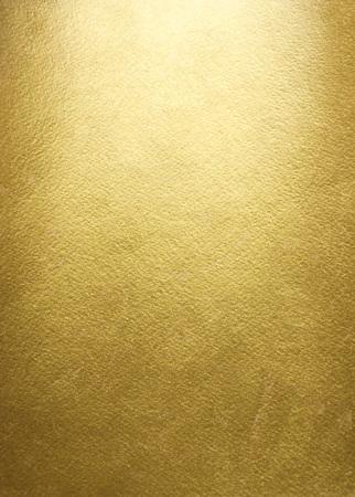 golden: Fondo del oro. Textura de oro en bruto. Plantilla de papel de oro de lujo para su diseño. Foto de archivo