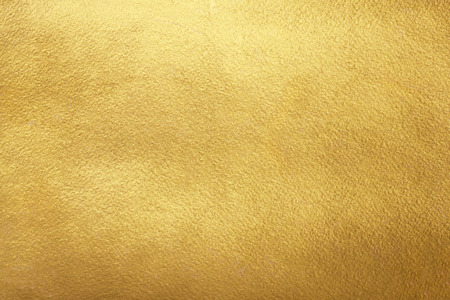 Gold background. Rough golden texture. Luxurious gold paper template for your design. Banco de Imagens
