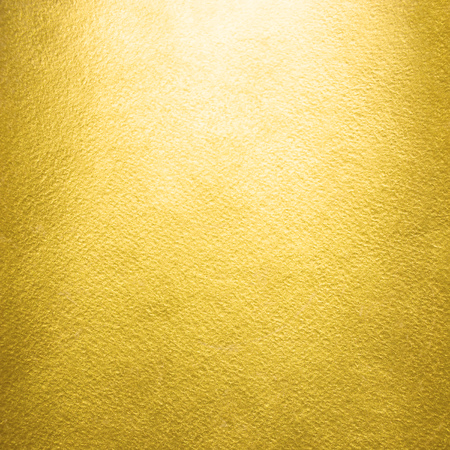 Gold background. Rough golden foil texture. Luxurious glittering gold paper template for your design.
