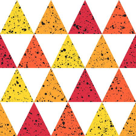 Triangles with black splash or blobs texture seamless pattern. Geometric colorful abstract background. Red, orange and yellow triangles with uneven spots, specks, blots texture.