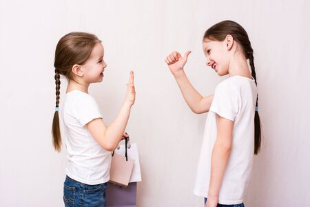 Girls meet after shopping and approve shopping
