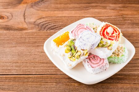 Traditional Turkish Delight on a plate on a wooden table