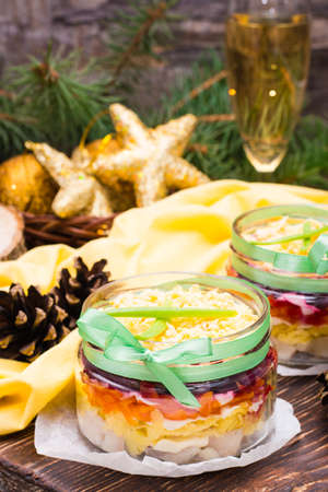 Traditional Russian salad - herring under a fur coat in bowls