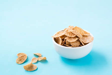 Cereal breakfast cereal dry breakfast in a bowl on a blue background