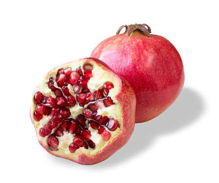 Juicy pomegranate and its half isolated on a white background. Banque d'images