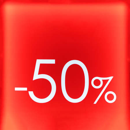 Seasonal sale, black friday and shopping concept. Red stand 50% discount in the store Reklamní fotografie