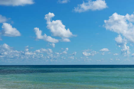 Seascape with tricolor water and cloudy sky. 版權商用圖片