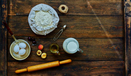 tucker: The trendy bakery chef laid on the table ingredients for bagels fresh fruit. On the table are the products for baking flour, eggs, milk and fresh fruit Stock Photo