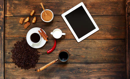 unusually: The restaurant waiter unusually served coffee on the table is a cup of coffee near as decoration chili, cookies of the best confectionery Stock Photo