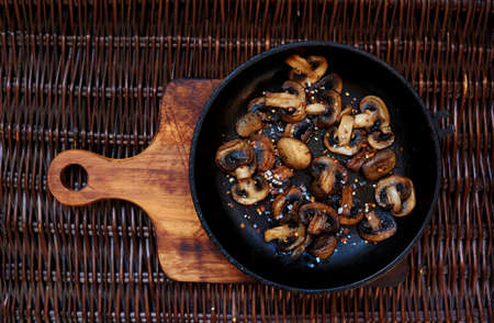 protein source: Fresh mushrooms collected in the forest fried in a deep frying pan,mushroom protein source,space for text Stock Photo