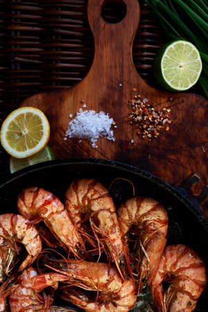near beer: Prawns fried and served with cold beer as a snack, situated near the lime and lemon, for those who want to spice up their