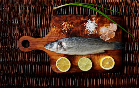 microelements: Cook unfrozen fresh sea bass to cook it on the grill. Small seabass excellent dinner useful in large fish kolichesvo useful microelements Stock Photo