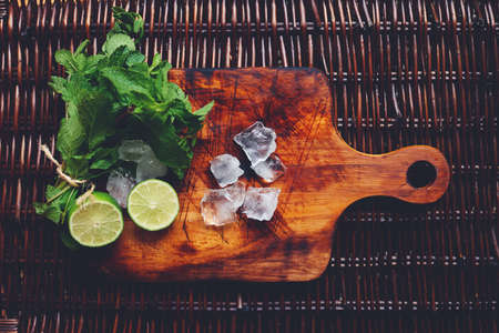 cocktail: ingredients of summer cocktail mojito on the wooden desk
