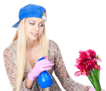 attentiveness: Young blonde woman with gardening tools, isolated on white