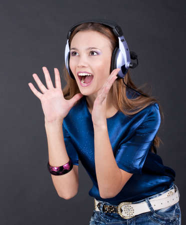 Music bright girl with headphones, background is black  photo