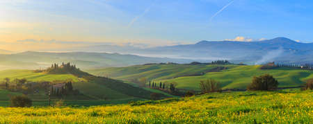 Misty sunrise in Tuscany, central Italy, which extends from the hills south of Siena to Monte Amiata.