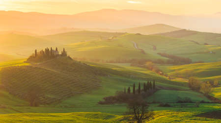 val d'orcia: Misty sunrise in Tuscany, central Italy, which extends from the hills south of Siena to Monte Amiata.