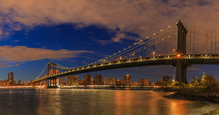 View to Manhattan from Brooklyn Bridge Park at sunset Stock Photo