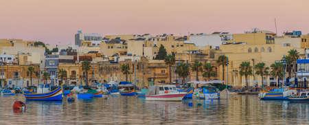 Marine with boats in fishing village Marsascala at sunrise Reklamní fotografie