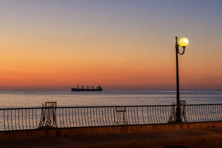 Silhouette of the boat in the sea before sunrise