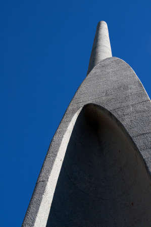 Afrikaans Language Monument shot on blue sky background in Paarl, Western Cape, South Africa. The longest tower of the monument shot from the bottom up. photo
