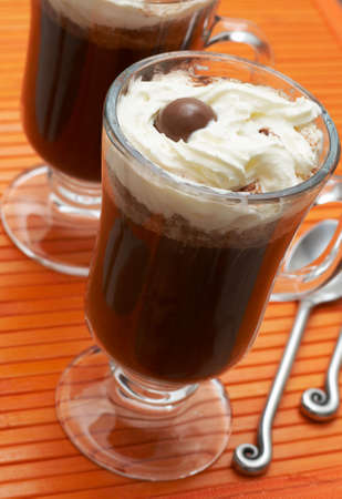 Closeup of coffee with cream (Caffe Borgia) with spoons next to it