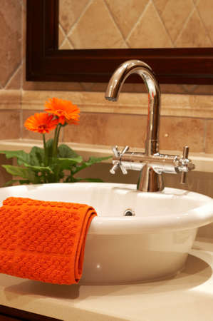 Beautiful sink in a bathroom with towel on it and a flower Stock Photo - 2205298