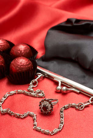 Beautiful black purse with silver chain handles, beautiful engagement ring and chocolate truffles - perfect Valentines day gift photo