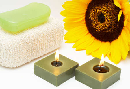 glycerin soap: Relaxing spa scene with body sponge, glycerin soap, candles and sunflower