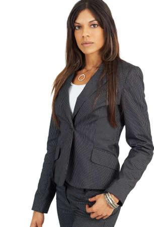 Beautiful successful brunette businesswoman in pinstripe suit. Isolated on white background with copy space