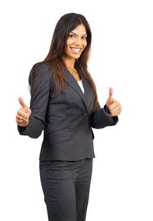 Beautiful brunette businesswoman in pinstripe suit giving thumbs up. Isolated on white background with copy space photo