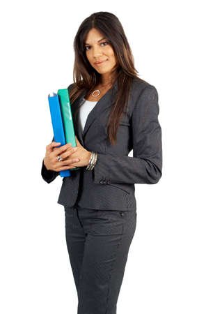 Beautiful brunette businesswoman in pinstripe suit holding files. Isolated on white background with copy space photo