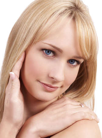 Portrait of a young beautiful blonde woman with light blue eyes and natural make-up