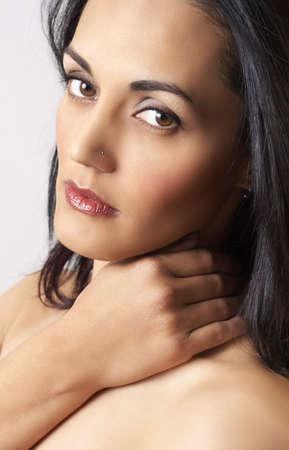 sexy mature women: Portrait of a beautiful mature brunette woman with dramatic make-up and soft skin Stock Photo