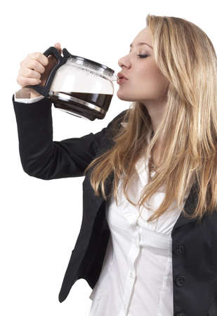 Beautiful blonde businesswoman wearing office clothes drinking coffee out of the pot. Isolated on white background  Stock Photo