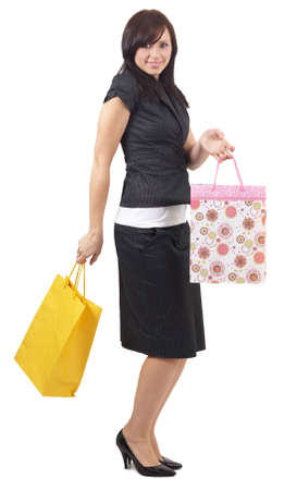Portrait of a beautiful young brunette woman wearing a professional suit holding shopping bags, isolated on white background Stock Photo - 3567147