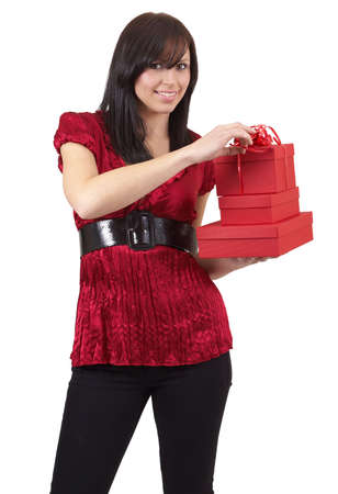 Portrait of a beautiful young brunette woman holding gift boxes at a celebration. Isolated on white background photo