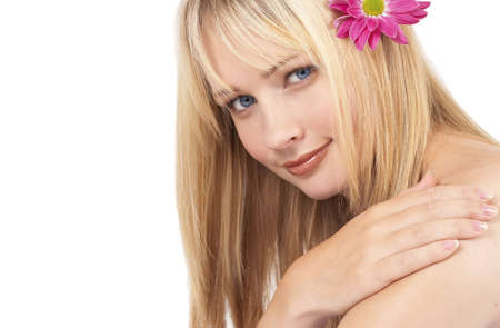 Portrait of a beautiful blonde woman with light blue eyes and natural make-up isolated on white background photo